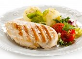 Grilled chicken fillet, French fries and vegetables