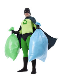 foto of segregation  - Eco superhero holding green and blue plastic bags full of domestic trash standing on white background  - JPG