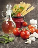 Italian Pasta With Tomatoes, Garlic, Olive Oil And Italian Parsley On Wooden Background