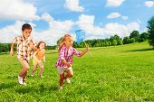6 ,7 Kids Running With Butterfly Net