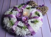 Decorative wreath with candles on wooden background