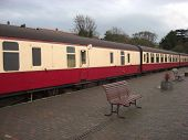 picture of passenger train  - Old passenger train in train station in Sherringham England with many carriages - JPG