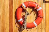 Orange Lifebuoy On Old Sailing Ship
