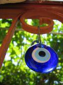 Evil Eye Talisman Or Amulet Hanging On A Garden Fence