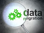 Data concept: Gears and Data Migration with optical glass