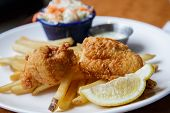 Fish And Chips With Lemon Wedge And Slaw