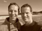 stock photo of gay couple  - Happy gay couple at the beach in sepia - JPG