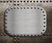 Rough metallic plate over rusty metal background.