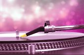 Dj Turntable With Pink Bokeh Background