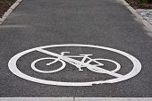 white painted sign for no bike line on asphalt pavement