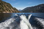 Trace Motor Boats On The Water Of A Mountain Lake.