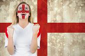 Excited fan england in face paint cheering against england flag in grunge effect
