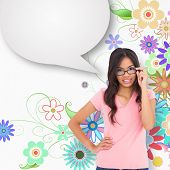 Pretty brunette thinking with speech bubble against digitally generated girly floral design
