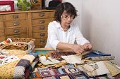 picture of quilt  - Mature woman by sewing and quilting in her home - JPG