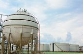 stock photo of lng  - Natural Gas Tank and row of large white tanks for petrol and oil - JPG