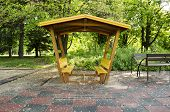 stock photo of pergola  - Wooden pergola painted yellow glazing built in the park - JPG