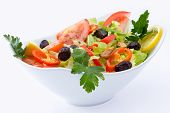 foto of oregano  - Fresh Mediterranean salad with black olives tomatoes parsley lemon peppers lettuce seasoned with olive oil lemon and oregano - JPG