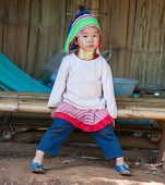 MAE HONG SON, CHIANG MAI, THAILAND - DEC 4, 2013: Unidentified Karen Long Neck child in traditional hill tribe village also known as Kayan indigenous  ethnic group. Famous tourist travel destination.