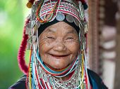 CHIANG RAI, THAILAND - DEC 4, 2013: Unidentified Akha tribe elderly woman in traditional clothes and