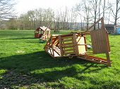 stock photo of swingset  - Wind damaged childrens playhouse and swingset after a spring storm