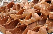stock photo of bast  - Russian National wicker shoes of birch bark  - JPG
