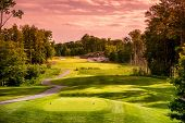 pic of sunrise  - Landscape of an empty golf course close to sunset or sunrise - JPG