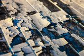 Old Wooden Planks With The Remains Of Cracked Oil-paint