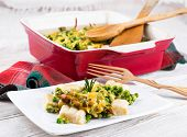 Cheese gnocchi with peas and rosemary