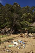 BAKO NATIONAL PARK, MALAYSIA - MAY 09 2014: Plastic pollution on remote tropical beach. Photo shows