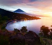 Calm lagoon with volcano Agung on the horizon at sunset, Bali, Indonesia