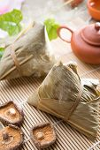 Traditional steamed sticky glutinous rice dumplings. Hot rice dumpling or zongzi. Chinese festive food. Asian cuisine.