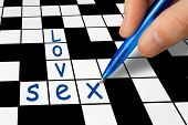 Hand filling in a crossword - Love and Sex
