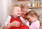 image of nana  - Cute little boy and little girl happy with grandmother - JPG