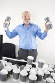 Happy businessman addicted to coffee