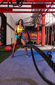 picture of battle  - battling ropes girl at gym workout exercise fitted body - JPG