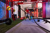 pic of battle  - battling ropes man at gym workout exercise fitted body - JPG