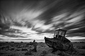 Abandoned Fishing Boat On Beach Landscape At Sunset Black And White