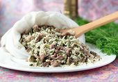 Uzbek Traditional Dish Green Pilaf In Bag On White Plate