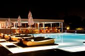Swimming Pool And Bar In Night Illumination At The Luxury Hotel, Crete Island, Greece