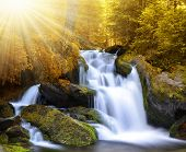 Autumnal landscape with waterfall in national park Sumava - Czech Republic