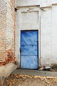 Blue vintage mediterranean door in obsolete wall and a lot of copyspace