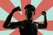 Silhouette of young man show his biceps brachii, closeup portrait.