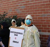 Protestor in infection control garb
