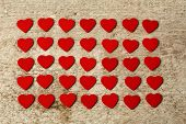 Valentines red hearts on wooden background