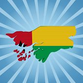 Guinea-Bissau map flag on blue sunburst illustration