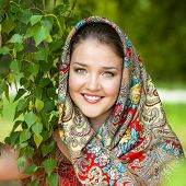 Russian beauty woman in the national patterned scarf