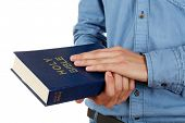 Man holding Bible isolated on white