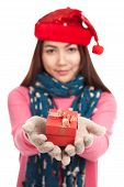 Asian Girl With Christmas Hat And Gift Box Focus At The Box