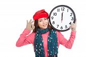 Asian Girl Show Ok  With Red Christmas Hat And  Clock At Midnight