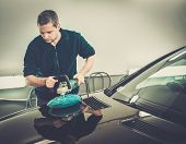 picture of washing-machine  - Man on a car wash polishing car with a polish machine  - JPG